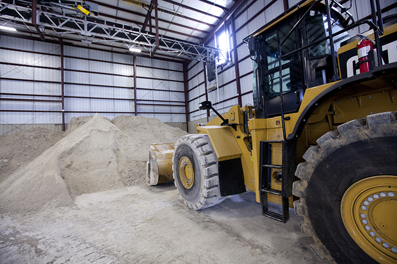 front end loader near a pile of gypsum