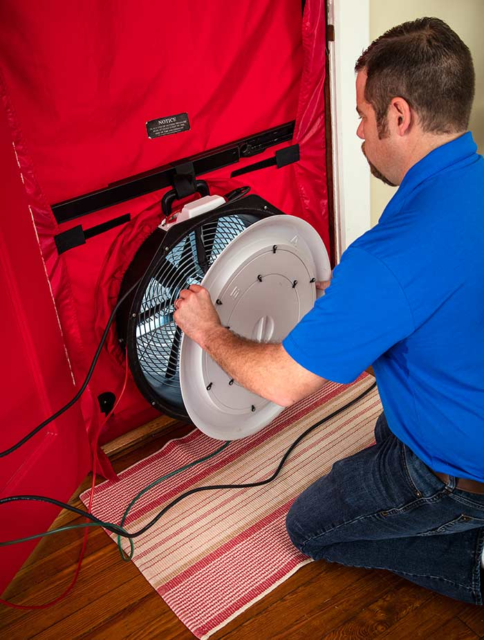 technician performing a blower door test