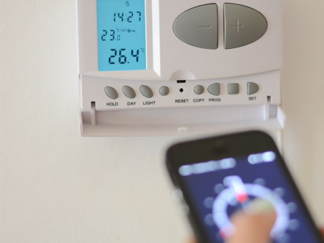 Phone app and thermostat