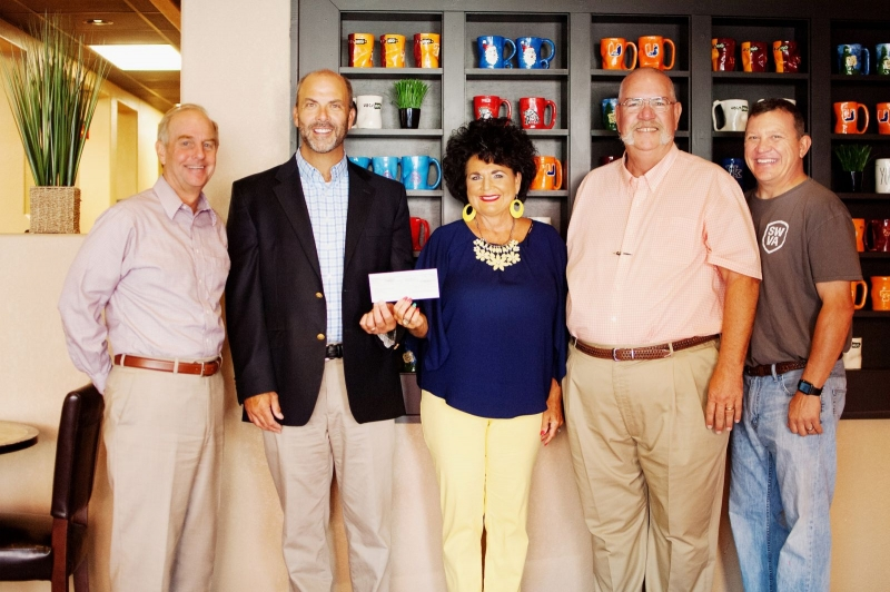 Stewart Spradlin and Darlene Long, area retail operations manager, presented The Gap Partnership committee members and Stephen Lawson, Big Stone Gap town manager, with a $10,000 donation
