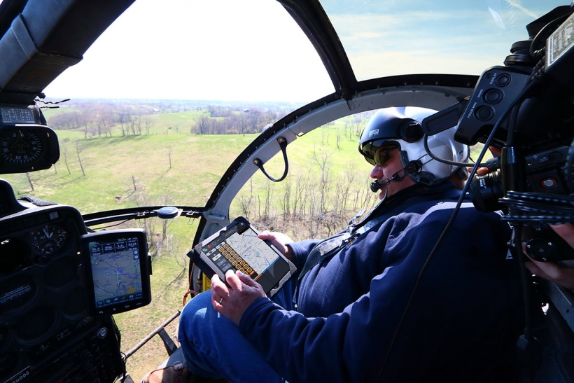 Air patrol helicopter surveying transmission lines