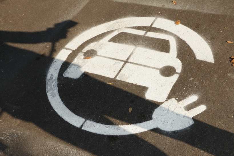 electric vehicle charging station symbol on street