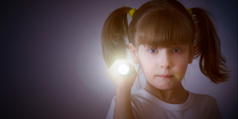 Little girl with flashlight