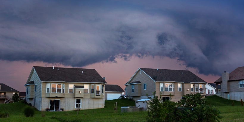 homes with storm clouds above them