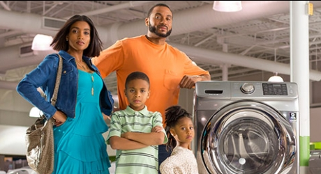 family in store standing next to washer
