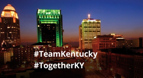 LG&E building lit with green. #TeamKentucky #TogetherKY
