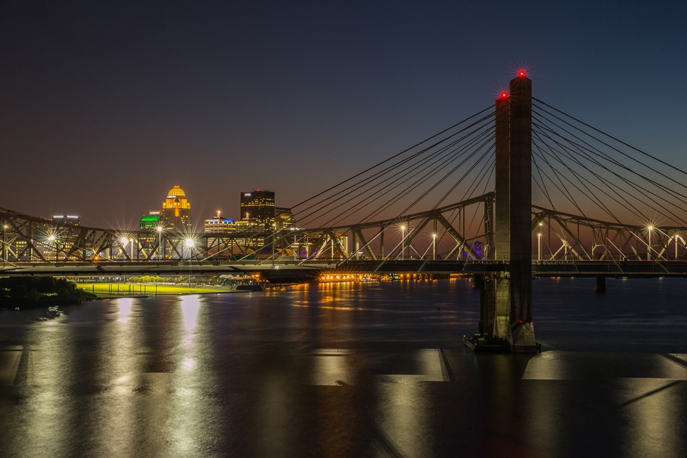nighttime skyline shot of Lincoln Bridge with Louisville in background