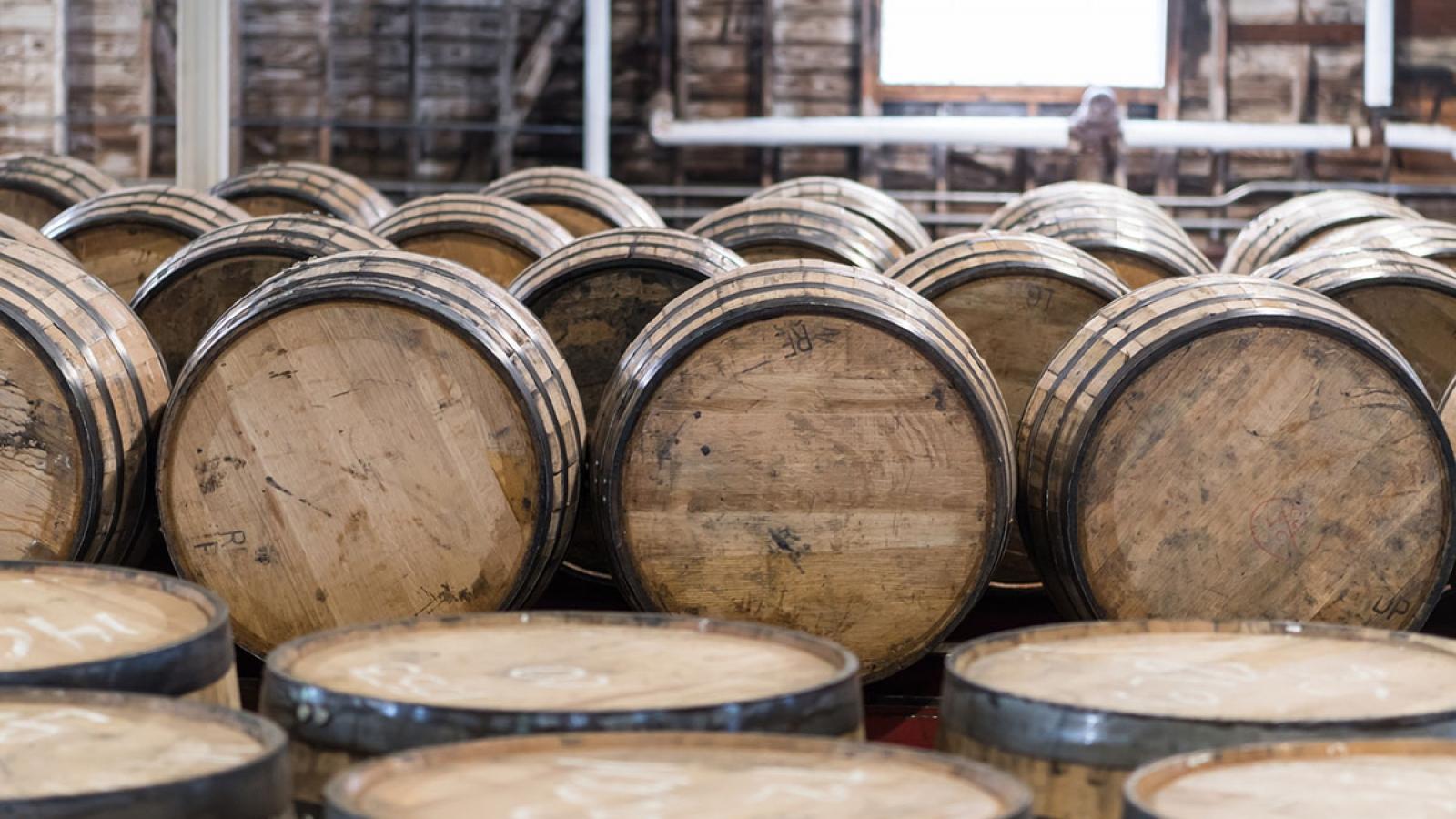 bourbon barrels inside a rickhouse