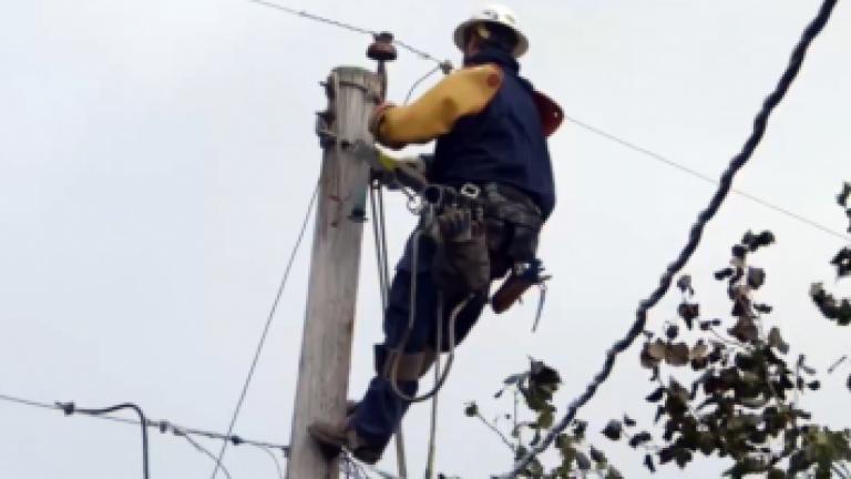 employee working on utility pole