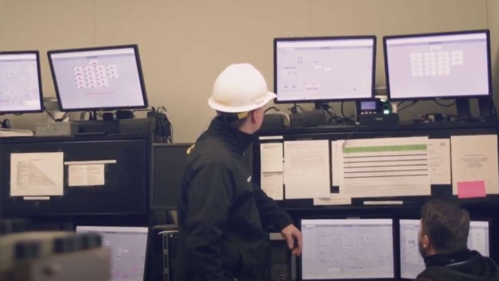 Dr. David Link looks at a monitor in a power plant