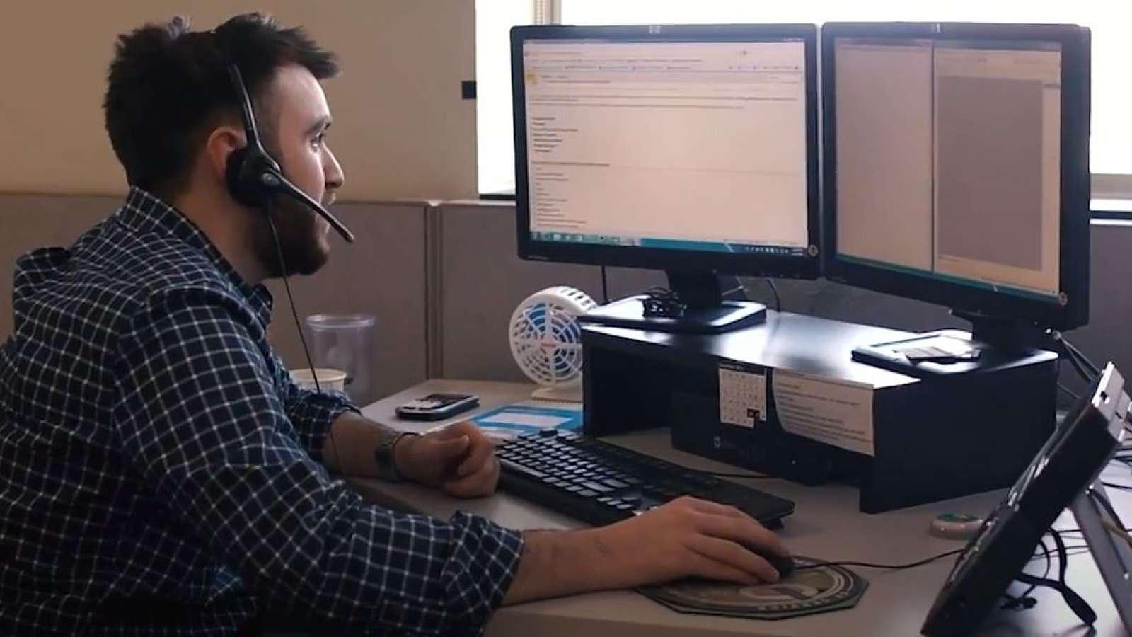 customer service representative wearing headset and talking to customer
