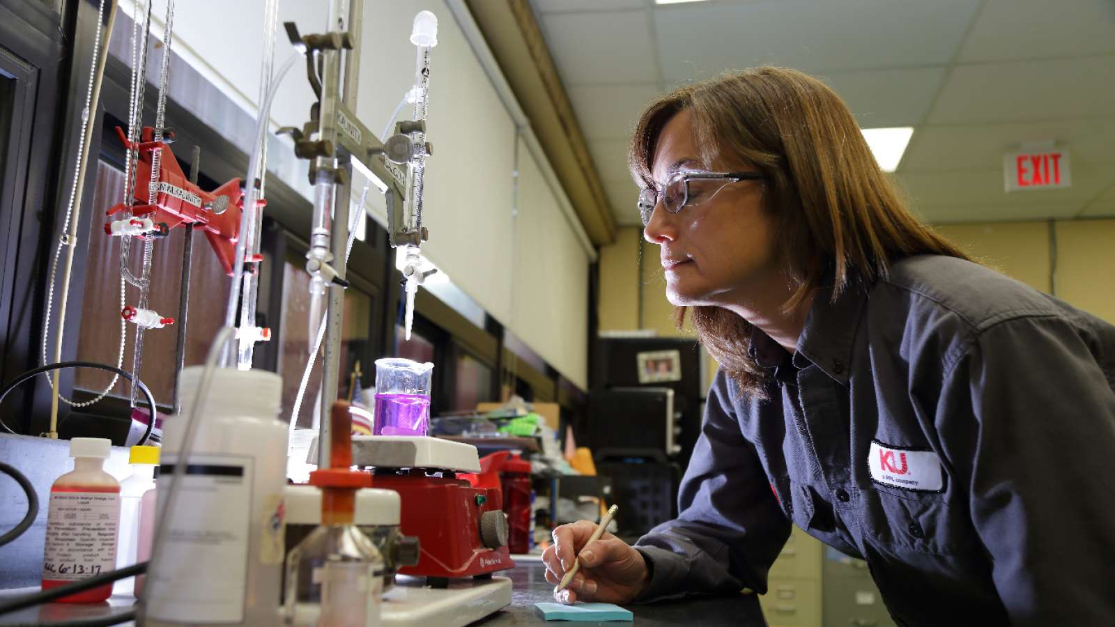 employee testing water in a lab