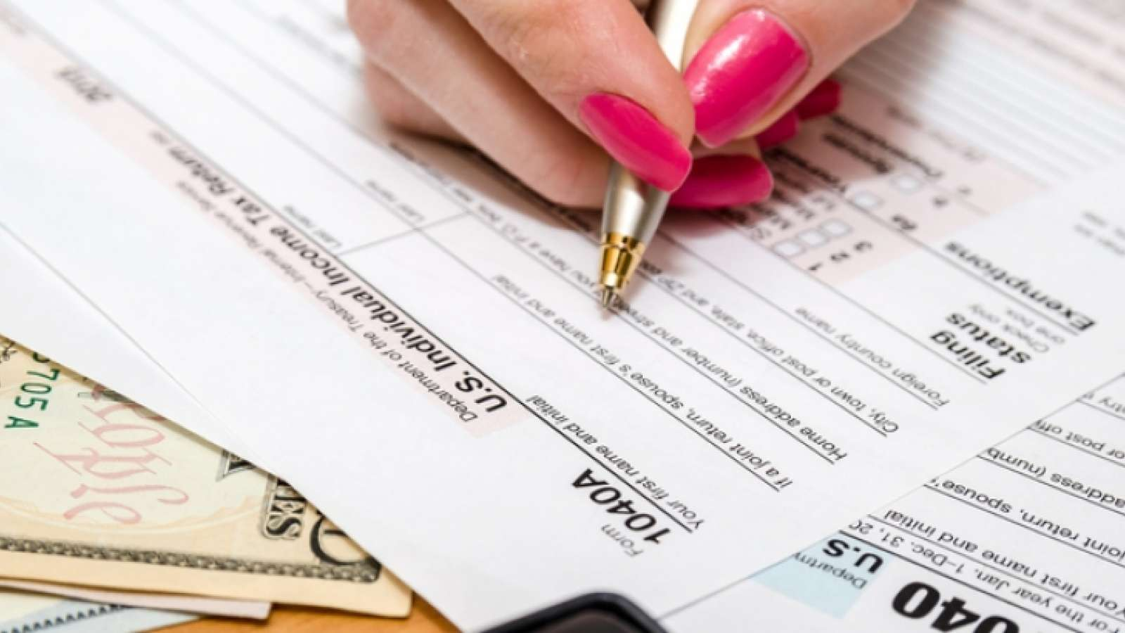 Woman filling out taxes