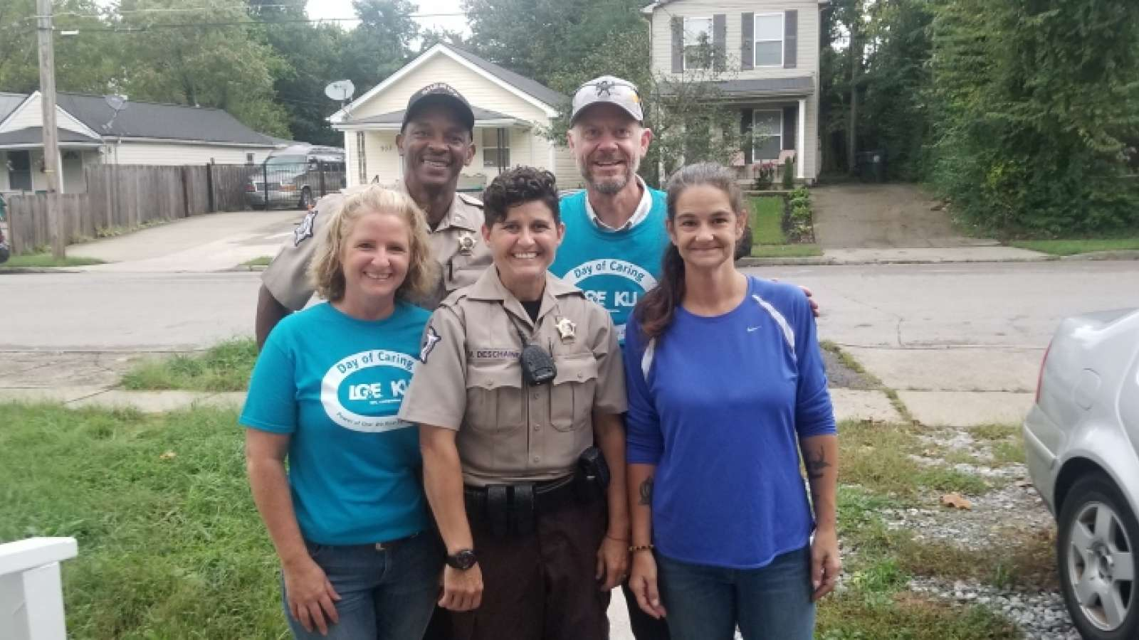 KU employees and sheriff deputy participating in community event
