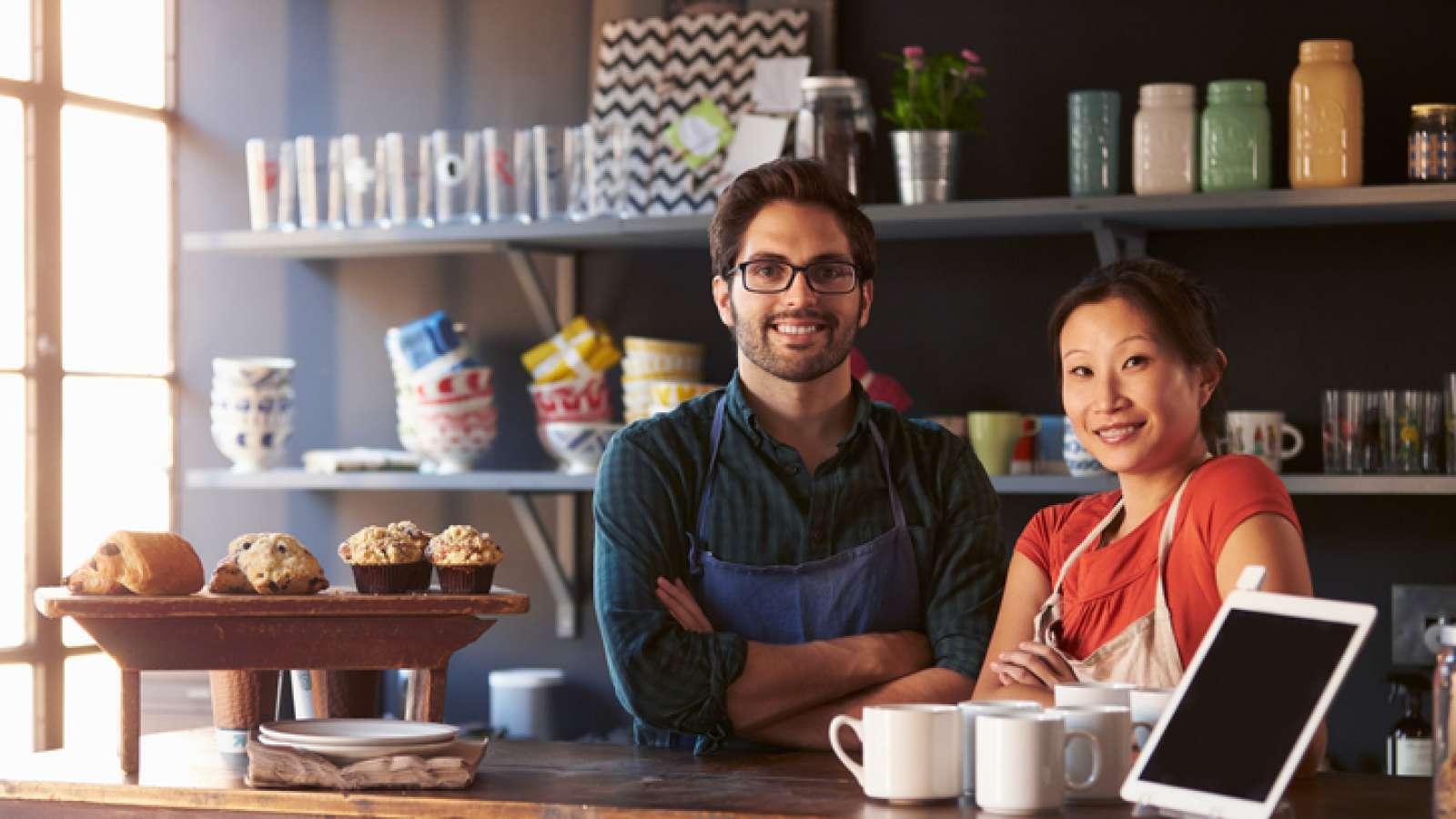 Man and woman behind counter at store