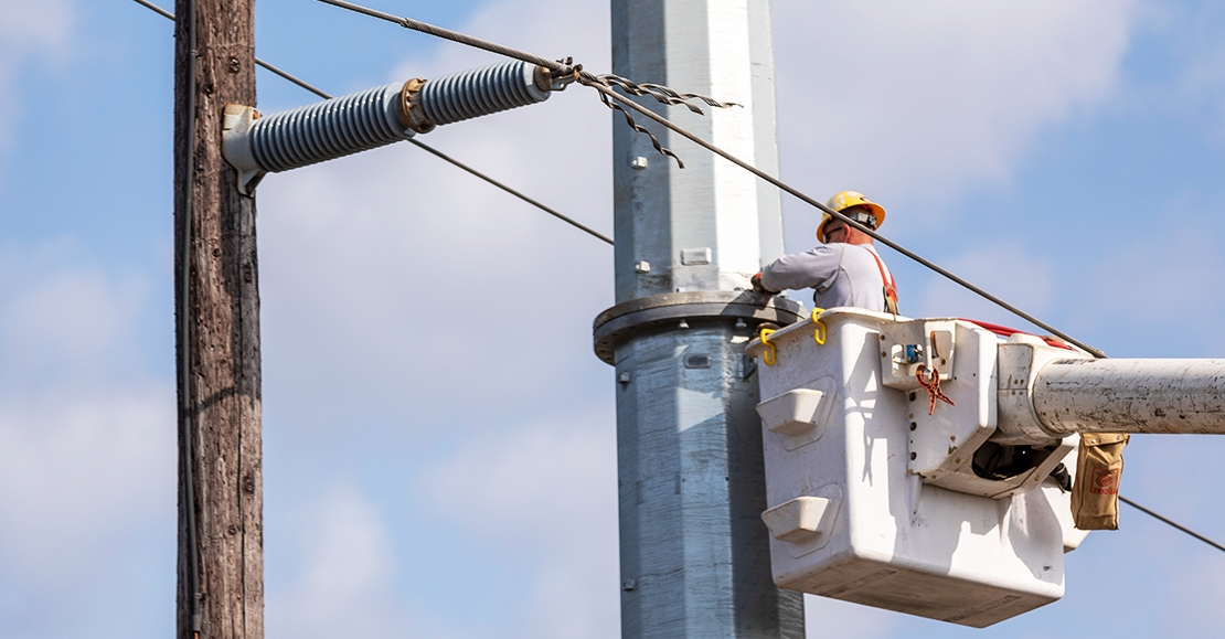 Utility worker, working on pole