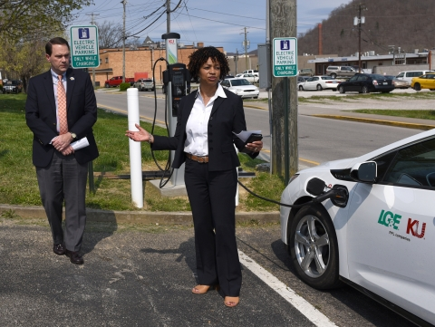 representative speaking at EV charger installation