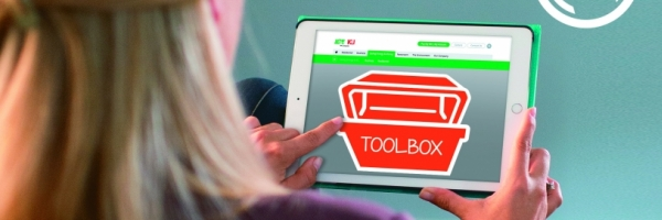 woman using tablet to visit our energy efficiency toolbox site