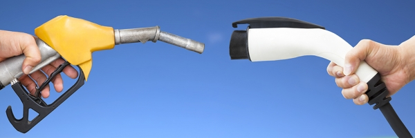 image of gas pump handle and EV charger handle