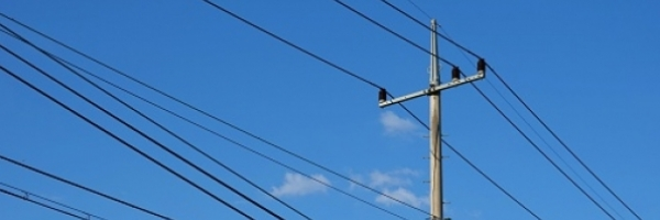 utility pole with power lines against a blue sky