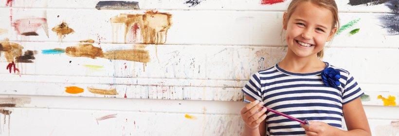 Girl holding paintbrush