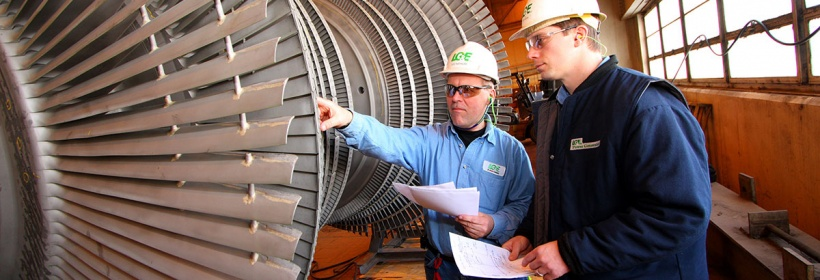 Cane Run employees inspecting a turbine