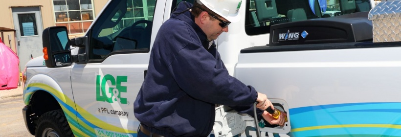 An employee at our Magnolia Natural Gas Compressor Station refuels one of two natural gas-powered trucks used in the station's daily operations.