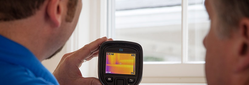 technician with a thermal imaging reader